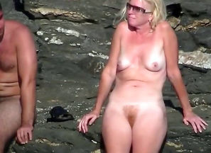 Mature naturist doll on the beach