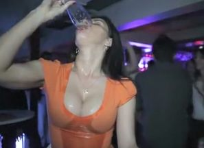 Club stunner chugs a beer in slow-motion