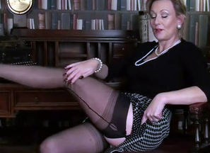 Mature taunt in seamed  and satin undies
